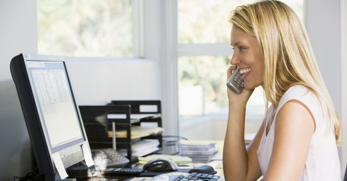 Business woman on phone and computer