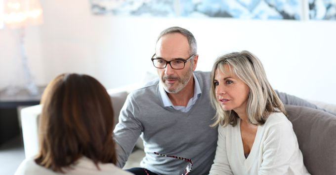 couple discussing estate planning with agent