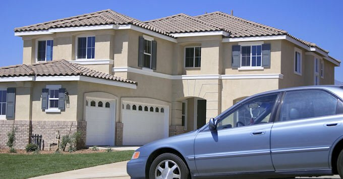 Suburban home with car in driveway